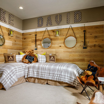 Mid-sized mountain style boy carpeted kids' room photo in Denver