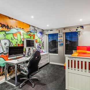 Mid-sized trendy boy carpeted kids' room photo in Perth with multicolored walls