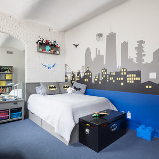 Urban boy carpeted and blue floor kids' room photo in New York with multicolored walls
