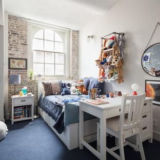 Inspiration for an industrial kids' room for boys in New York with white walls, carpet and blue floors.