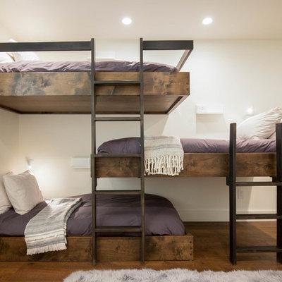 Trendy gender-neutral dark wood floor kids' room photo in Orange County with white walls