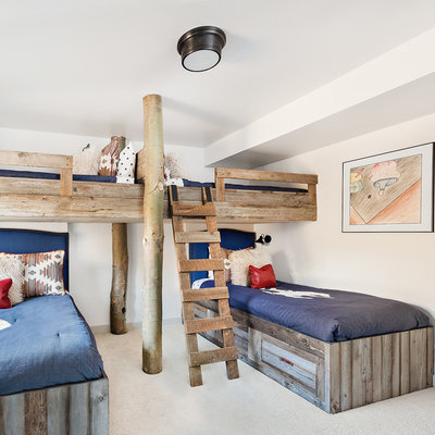 Mid-sized mountain style gender-neutral dark wood floor and brown floor kids' bedroom photo in Other with white walls