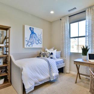 Example of a coastal gender-neutral carpeted and beige floor kids' bedroom design in Orange County with beige walls