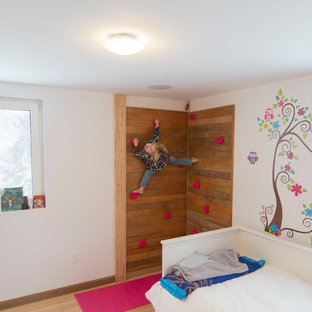 Example of a mid-sized trendy girl light wood floor and beige floor childrens' room design in Boston with white walls