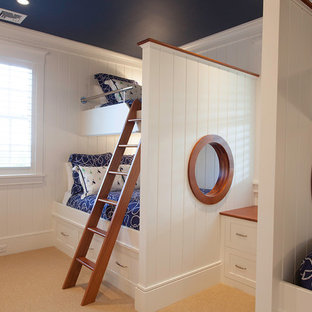 Beach style gender-neutral kids' room photo in Boston with white walls
