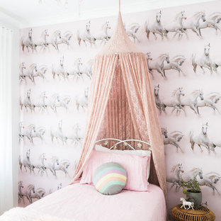 This is an example of a contemporary kids' bedroom for kids 4-10 years old and girls in Perth with multi-coloured walls, light hardwood floors and wallpaper.
