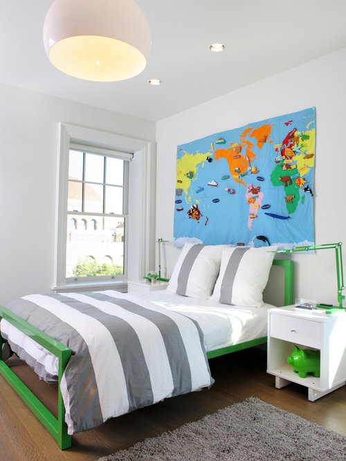 Trendy gender-neutral brown floor and medium tone wood floor kids' bedroom  photo in