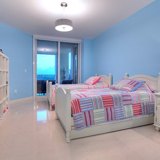 This is an example of a large bohemian children's room for girls in Miami with blue walls and marble flooring.