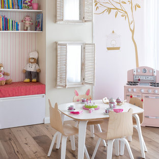 Inspiration for a mid-sized beach style girl light wood floor kids' room remodel in Miami with pink walls