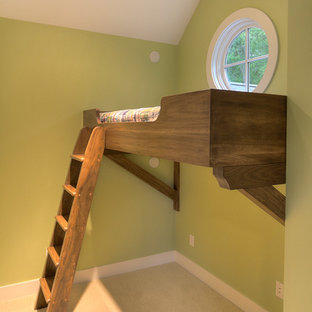 This is an example of a traditional gender-neutral kids' bedroom in Other with green walls and carpet.