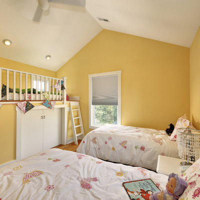 Example of a classic girl kids' room design in Philadelphia with yellow walls