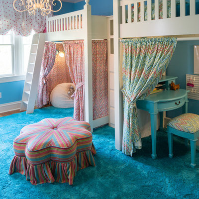 Kids' room - large traditional girl medium tone wood floor kids' room idea in Indianapolis with blue walls
