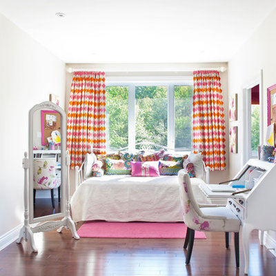 Example of a classic girl kids' bedroom design in Montreal with gray walls