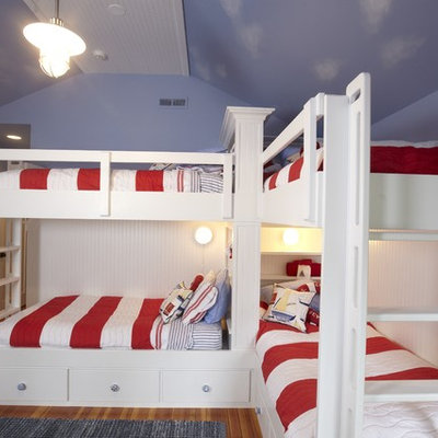 Example of a classic gender-neutral medium tone wood floor kids' room design in Tampa with blue walls