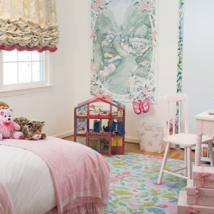 Cottage chic girl medium tone wood floor kids' room photo in DC Metro with white walls