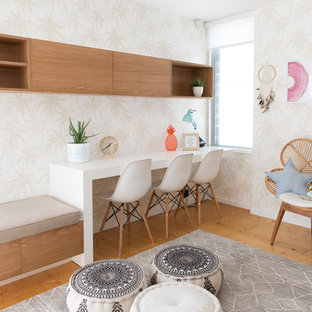 Design ideas for a large contemporary gender-neutral kids' room in Gold Coast - Tweed with beige walls, medium hardwood floors and beige floor.
