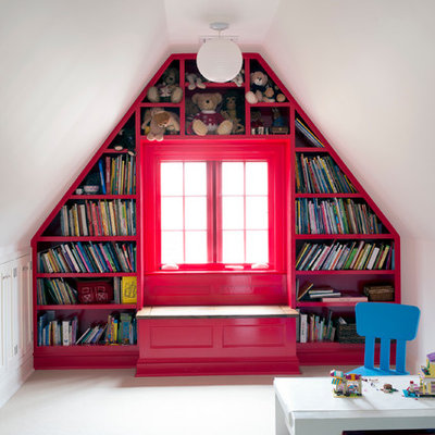 Kids' room - mid-sized traditional gender-neutral carpeted kids' room idea in New York with red walls
