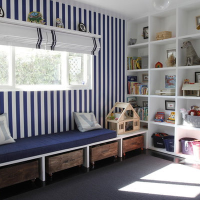 Example of a large transitional gender-neutral dark wood floor kids' room design in Los Angeles with multicolored walls