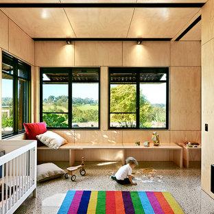 Diseño de dormitorio infantil de 1 a 3 años, contemporáneo, grande, con suelo de cemento