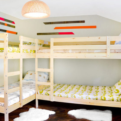 Example of a mountain style gender-neutral dark wood floor kids' room design in Portland Maine with gray walls