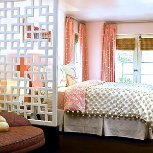 Kids' room - contemporary girl carpeted kids' room idea in Los Angeles with pink walls
