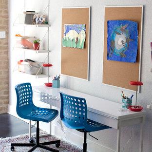 Mid-sized minimalist gender-neutral concrete floor kids' room photo in Austin with white walls
