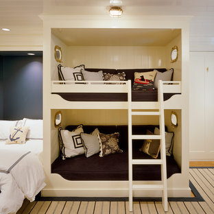 Example of a beach style gender-neutral kids' bedroom design in Boston with blue walls