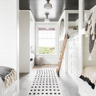 Beach style gender-neutral kids' room photo in Charleston with white walls