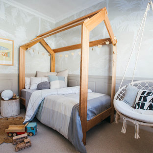 Design ideas for a mid-sized transitional kids' bedroom for kids 4-10 years old and girls in Sydney with grey walls, carpet and grey floor.