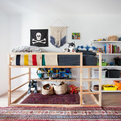 Inspiration for a 1950s boy dark wood floor kids' room remodel in Los Angeles with white walls