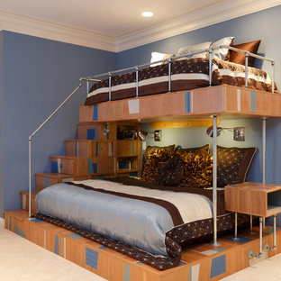 Example of a trendy boy carpeted kids' room design in St Louis with blue walls