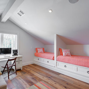 Inspiration for a farmhouse girl medium tone wood floor and brown floor kids' bedroom remodel in San Francisco with white walls