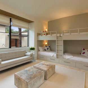 На фото: большая нейтральная детская в современном стиле с полом из известняка, спальным местом и бежевыми стенами для подростка с