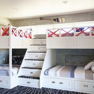 Kids' bedroom - large coastal gender-neutral carpeted and black floor kids' bedroom idea in Other with multicolored walls