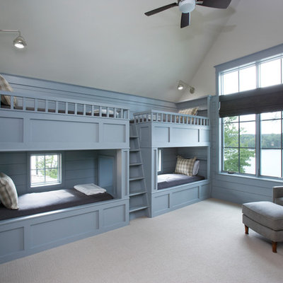 Example of a beach style gender-neutral carpeted and gray floor kids' room design in Other with blue walls