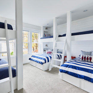 Coastal gender-neutral carpeted and gray floor kids' bedroom photo in Raleigh with white walls