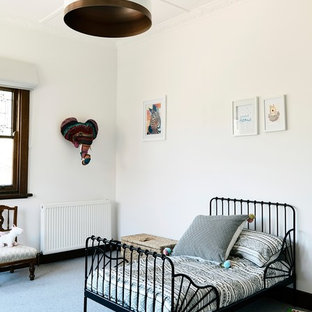 Scandinavian gender-neutral kids' bedroom in Other with white walls, carpet and grey floor for kids 4-10 years old.