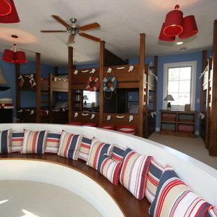 Imagen de dormitorio infantil de 4 a 10 años, tradicional, con paredes azules y moqueta