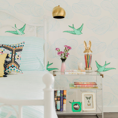 Large transitional girl brown floor and dark wood floor kids' room photo in New York with multicolored walls