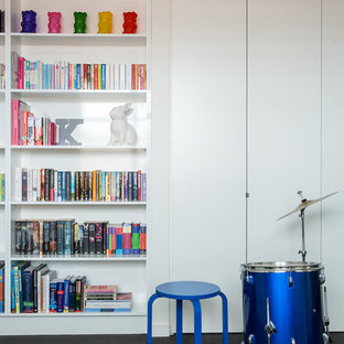 This is an example of a modern kids' room in Melbourne with white walls, carpet and grey floor.