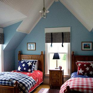 Kids' room - traditional gender-neutral medium tone wood floor kids' room idea in Richmond with blue walls