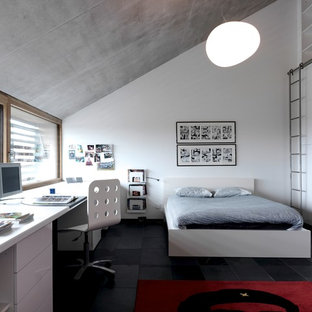 Kids' room - contemporary gender-neutral kids' room idea in San Diego with white walls