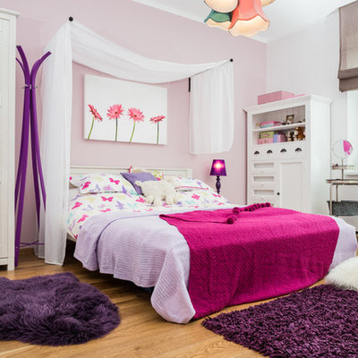 Elegant girl light wood floor kids' room photo in Other with multicolored walls