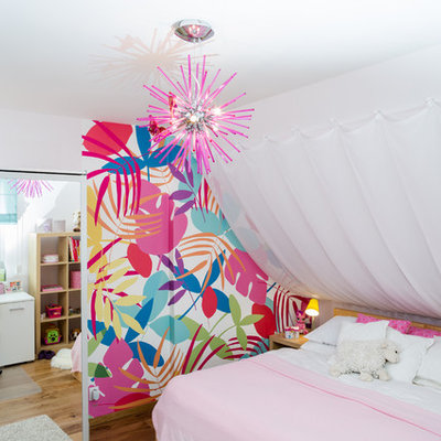 Eclectic girl medium tone wood floor kids' room photo in Other with white walls