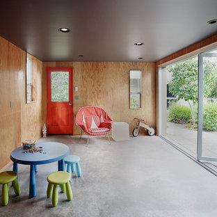 Foto di una cameretta per bambini da 4 a 10 anni moderna di medie dimensioni con pavimento in cemento