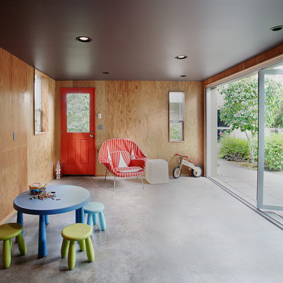 Inspiration for a mid-sized mid-century modern gender-neutral concrete floor kids' room remodel in Seattle