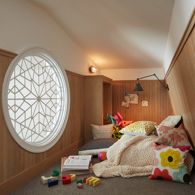Example of a transitional gender-neutral carpeted and gray floor kids' room design in Chicago with white walls