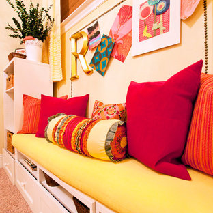 Design ideas for a small shabby-chic style kids' bedroom for kids 4-10 years old and girls in Chicago with orange walls and carpet.