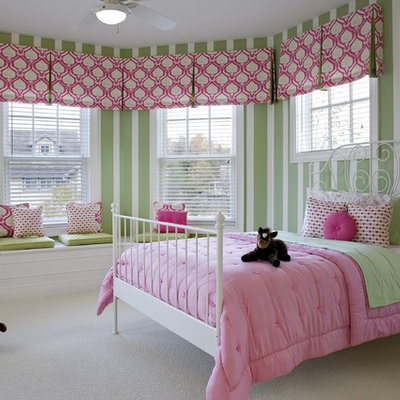 Example of a classic girl carpeted kids' room design in Detroit with multicolored walls