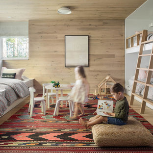 Photo of a contemporary kids' room in Boston with brown walls, light hardwood floors and brown floor.